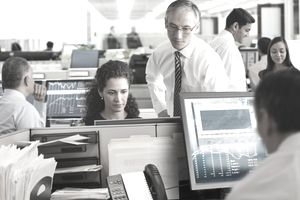 investors_traders looking at computer screen