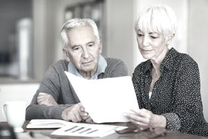 senior couple Looking at their individual retirement accounts