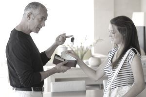 father and daughter discussing money and car keys