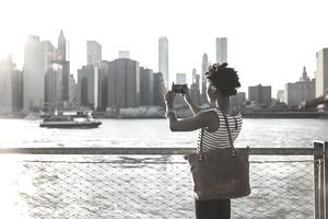 Woman Taking Cell Phone Photo