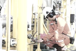 oil rig worker checking equipment
