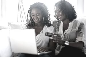 Mother and daughter shopping online with credit card