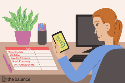 Image shows a girl sitting at her computer with her phone open to a dollar sign; there is a budgeting sheet in front of her.
