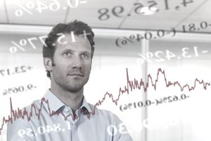 Businessman looking at financial market data