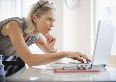 A taxpayer searches for tax filing forms on a laptop.