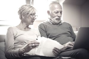 A middle-aged couple discuss problems with their pension fund.