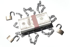 Stack of $100 notes released from chains.