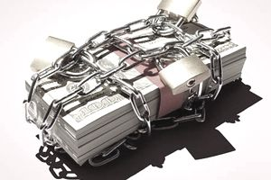 Stack of $100 bills in chains to reflect the personal money woes of bankruptcy