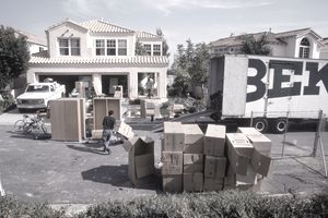 a moving truck and boxes stacked on the street