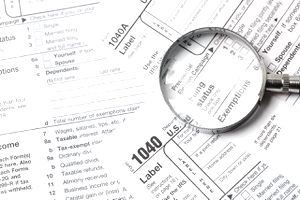 Tax notice and magnifying glass