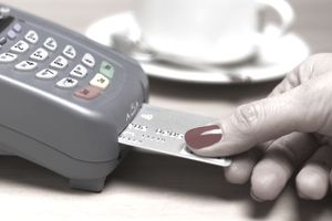 Woman using check card to pay
