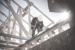 Builder Working on House Frame