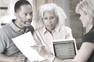 Older couple looking over their retirement plan with financial planner