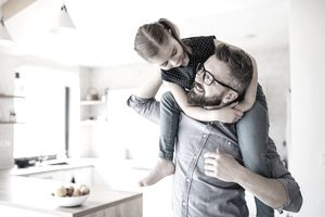 A man carries a girl on his back.