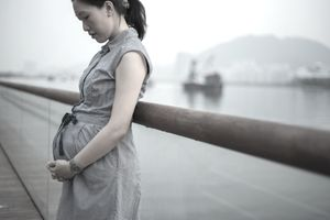 Pregnant women standing in waterfront