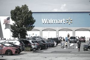 NORTH BERGEN, NJ - AUGUST 23: People past walk by a Walmart store on August 23, 2020 in North Bergen, New Jersey. Walmart saw its profits jump in latest quarter as e-commerce sales surged during the coronavirus pandemic