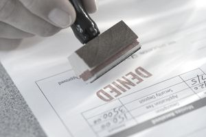 Denied stamp on a car loan application