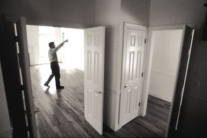 home inspector walking through empty house
