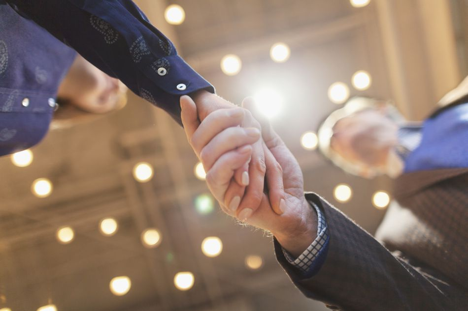 Man and woman shaking hands in an office
