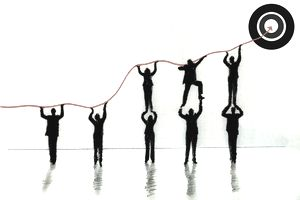 illustration of business people lifting graph to bullseye