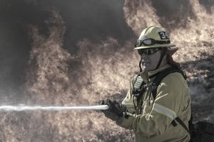 A firefighter protects homes during wildfires in California.