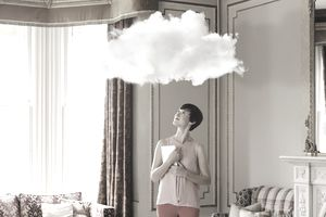 woman in home with cloud overhead