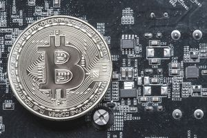 Close-Up View Of Bitcoin On Mother Board