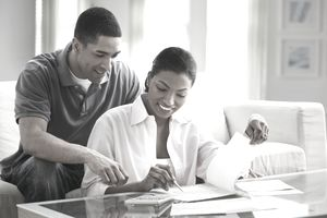 Man and woman taking reviewing new investments