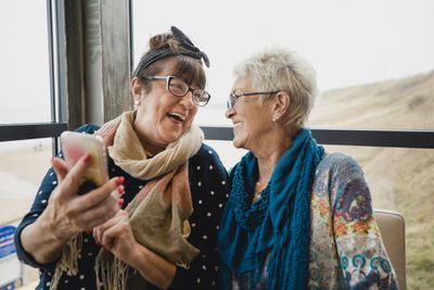 Two retired women enjoy some time together.
