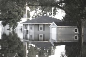 Houses in standing water during a flood.