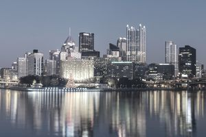 Pittsburgh, Pennsylvania skyline at blue hour from the riverbank