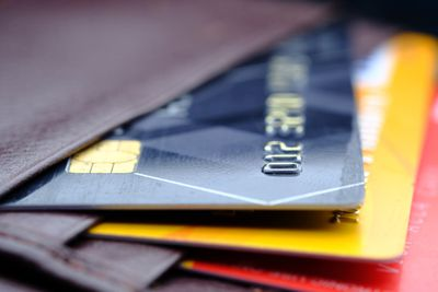 close-up of red, yellow, and blue credit cards in wallet