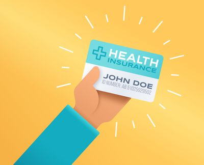 A person holding a health insurance card