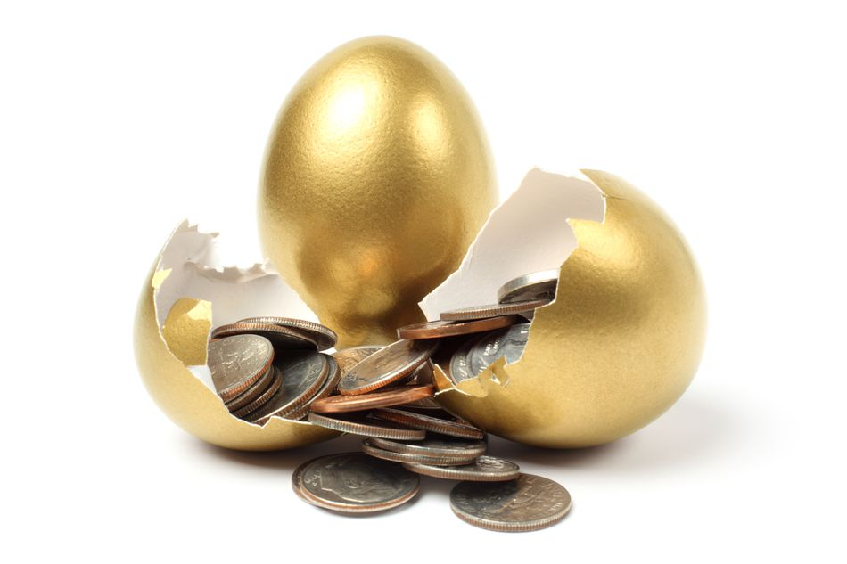 a broken golden egg with loose change inside