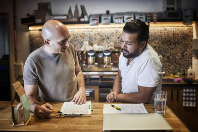 Business owner having discussion in coffee shop