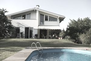 House with pool in backyard