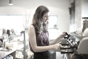 Young woman working at coffee shop