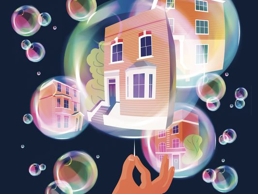 Hand with pin bursting housing bubble