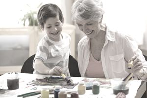 Grandmother and grandchild enjoy art together