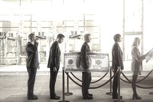 business people in line at a bank with one customer carrying an oversized 100 dollar bill