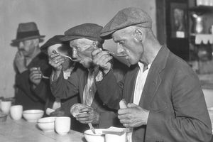 Men eating in a soup kitchen during the US Great Depression