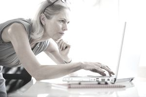 Businesswoman using laptop computer at desk