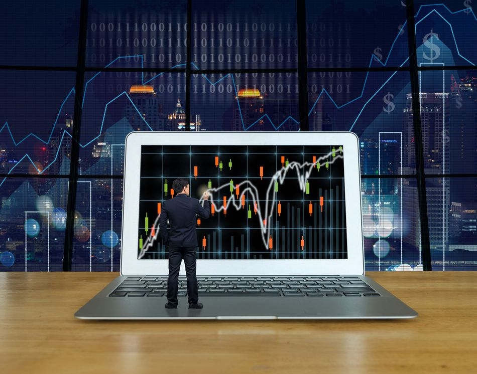 photo illustration of a man standing on a laptop tablet