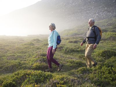 Retired couple hiking in the mountains.