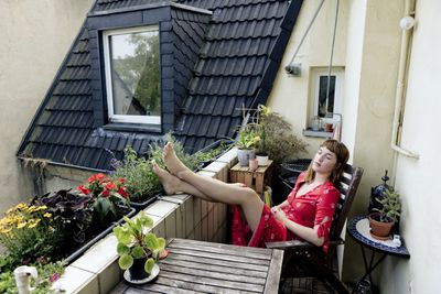 A resident lounges on a condo balcony