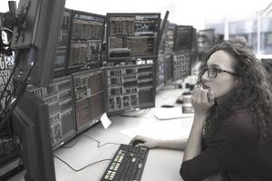 Young woman analyzing computer data