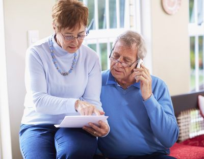 Senior couple reading document at home