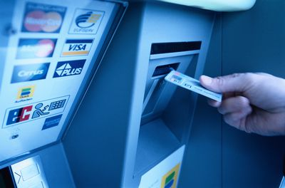Hand Putting Card into ATM