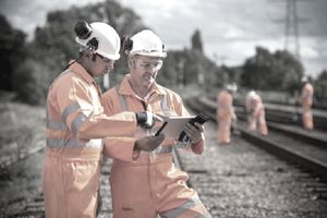 Railway workers using digital tablet