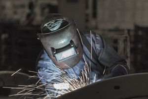 worker welding a metal part